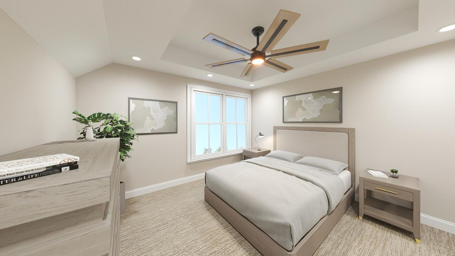 Secondary bedroom with tray ceiling