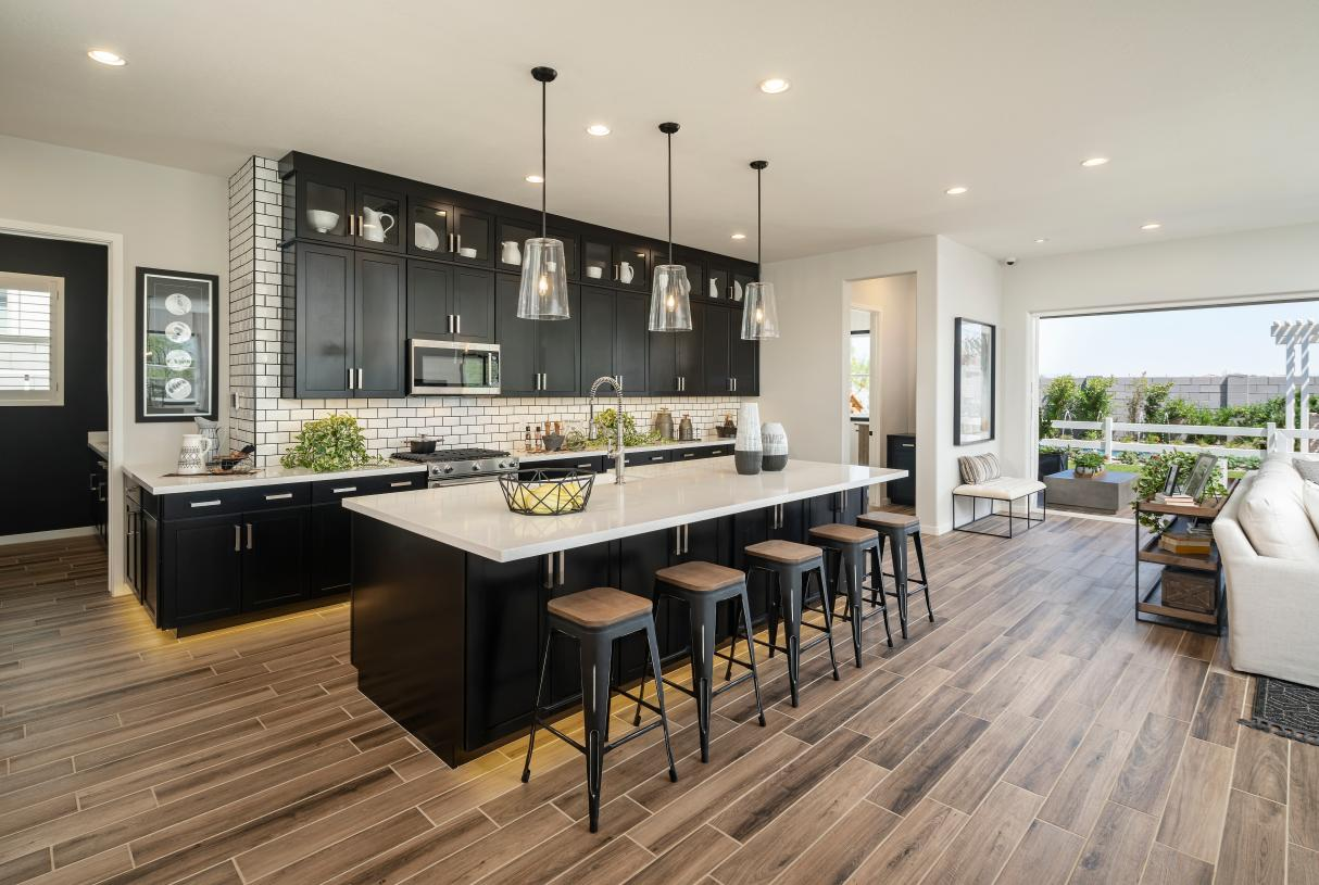 Stunning kitchen with breakfast bar, ample cabinet and countertop space