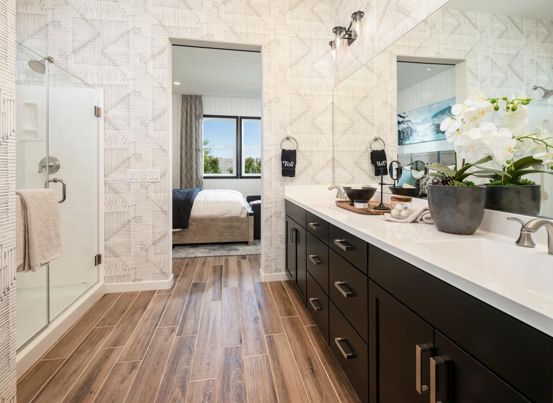 Lavish primary bathrooms with large walk-in shower