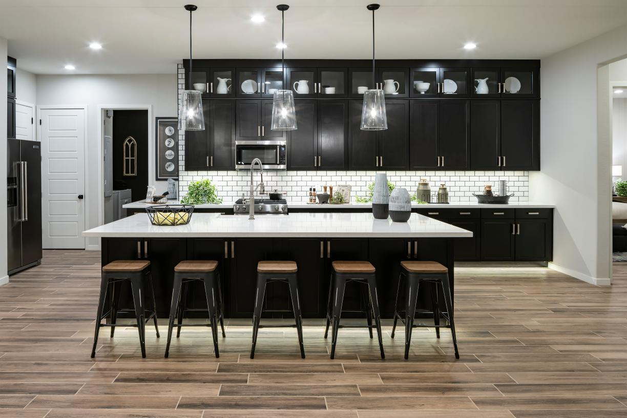 Well-designed kitchen with large center island, breakfast bar, and sizeable pantry