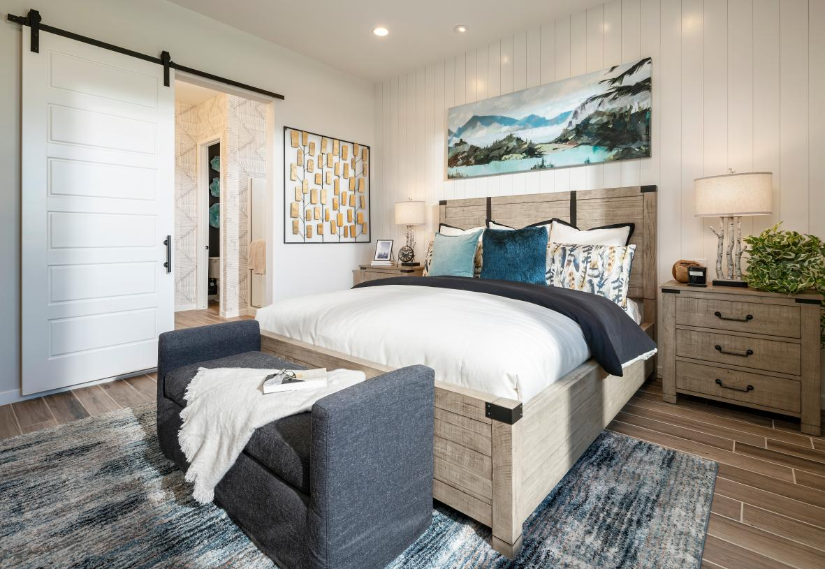 Large primary bedroom suite with natural light