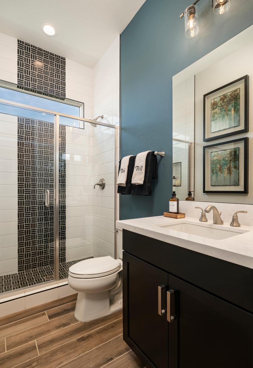 Beautiful secondary bathrooms with ample countertop and cabinet space