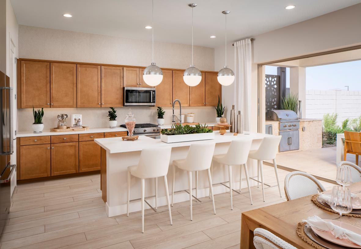 Well-equipped kitchen with ample countertop and cabinet space and a breakfast bar