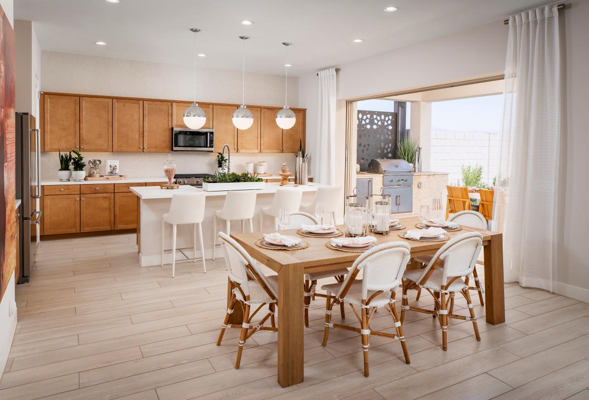 Open-concept floor plan with casual dining and spacious kitchen