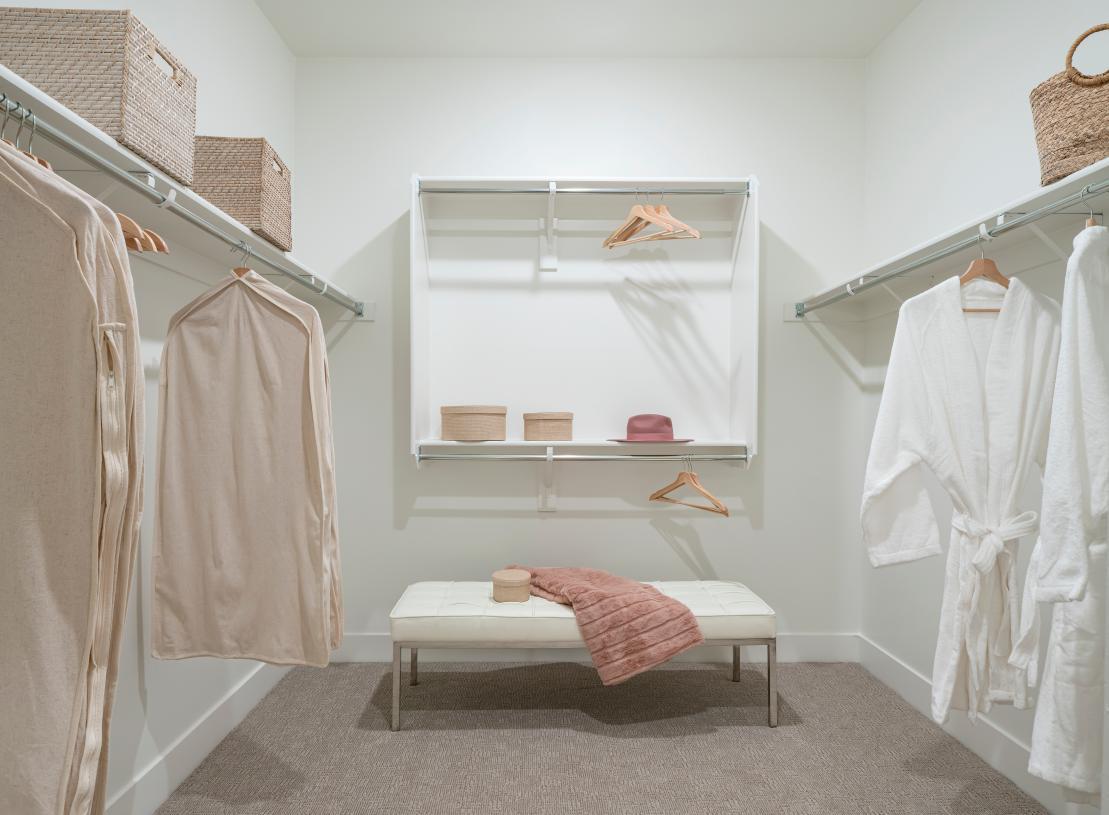 Spacious primary suite closet with ample storage
