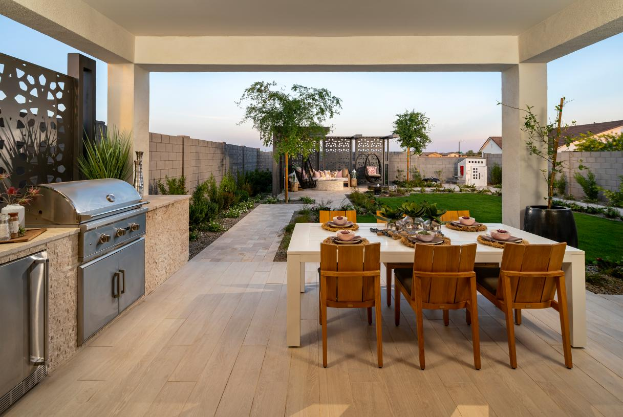 Covered patios for outdoor living and an outdoor kitchen for dining