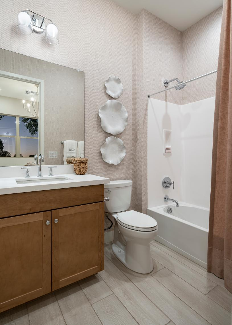 Secondary bathroom with ample countertop and cabinet space