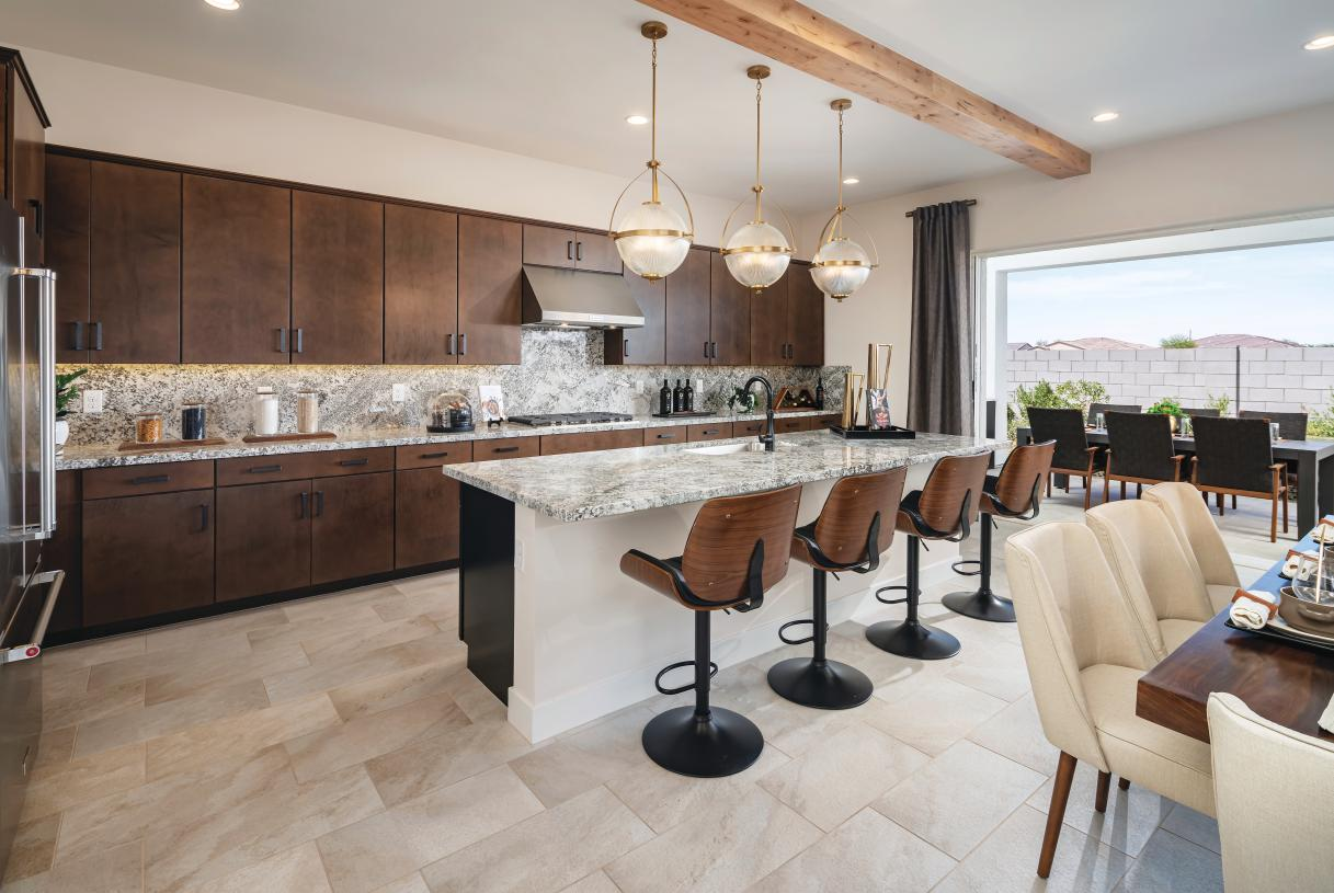 Stunning kitchens with views of the great room and backyard beyond