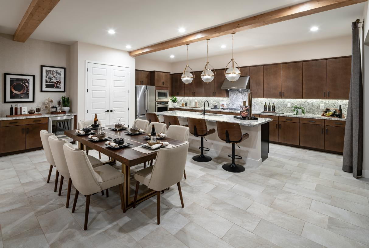 Well-equipped kitchen with large center island, breakfast bar, and sizeable pantry