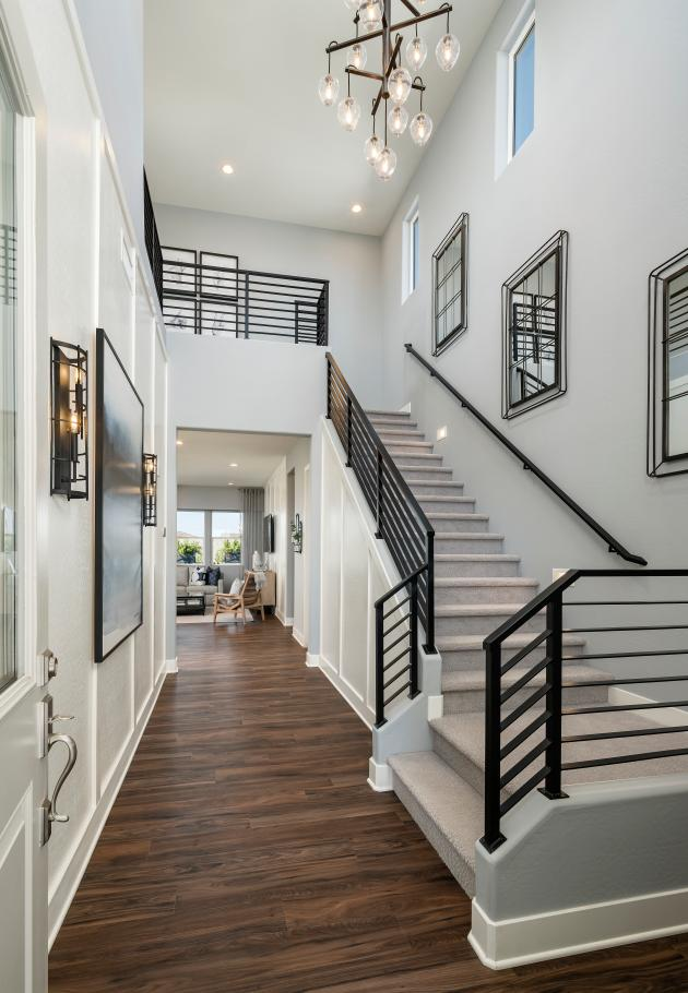 Welcoming foyer entry with views of the great room and backyard beyond