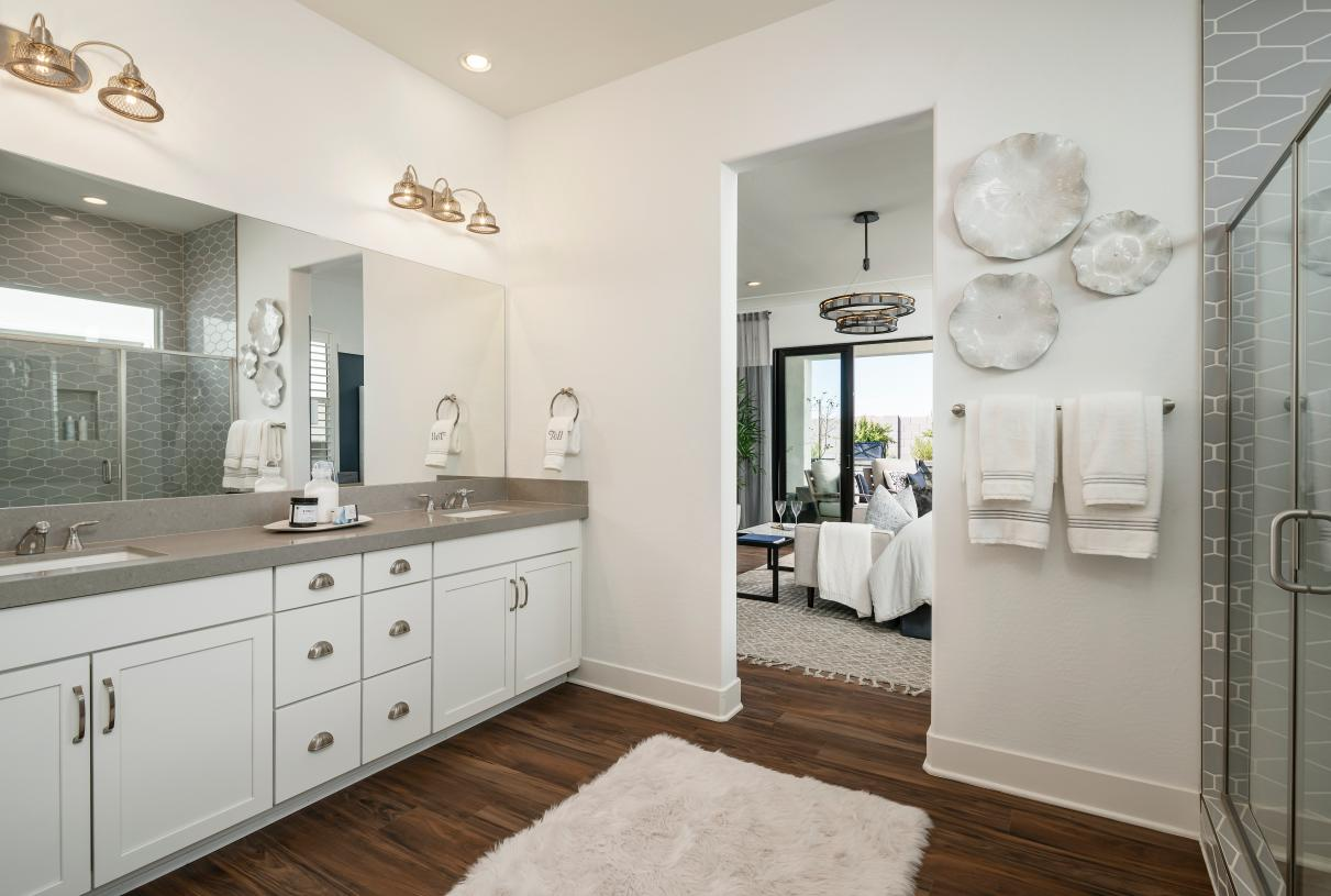 Lavish primary bathroom with large walk-in shower and huge closet