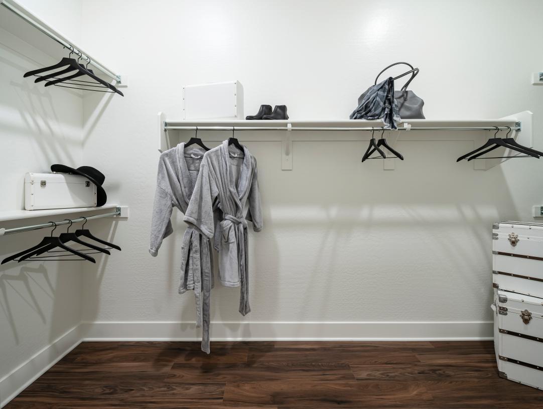 Spacious primary closet with ample storage