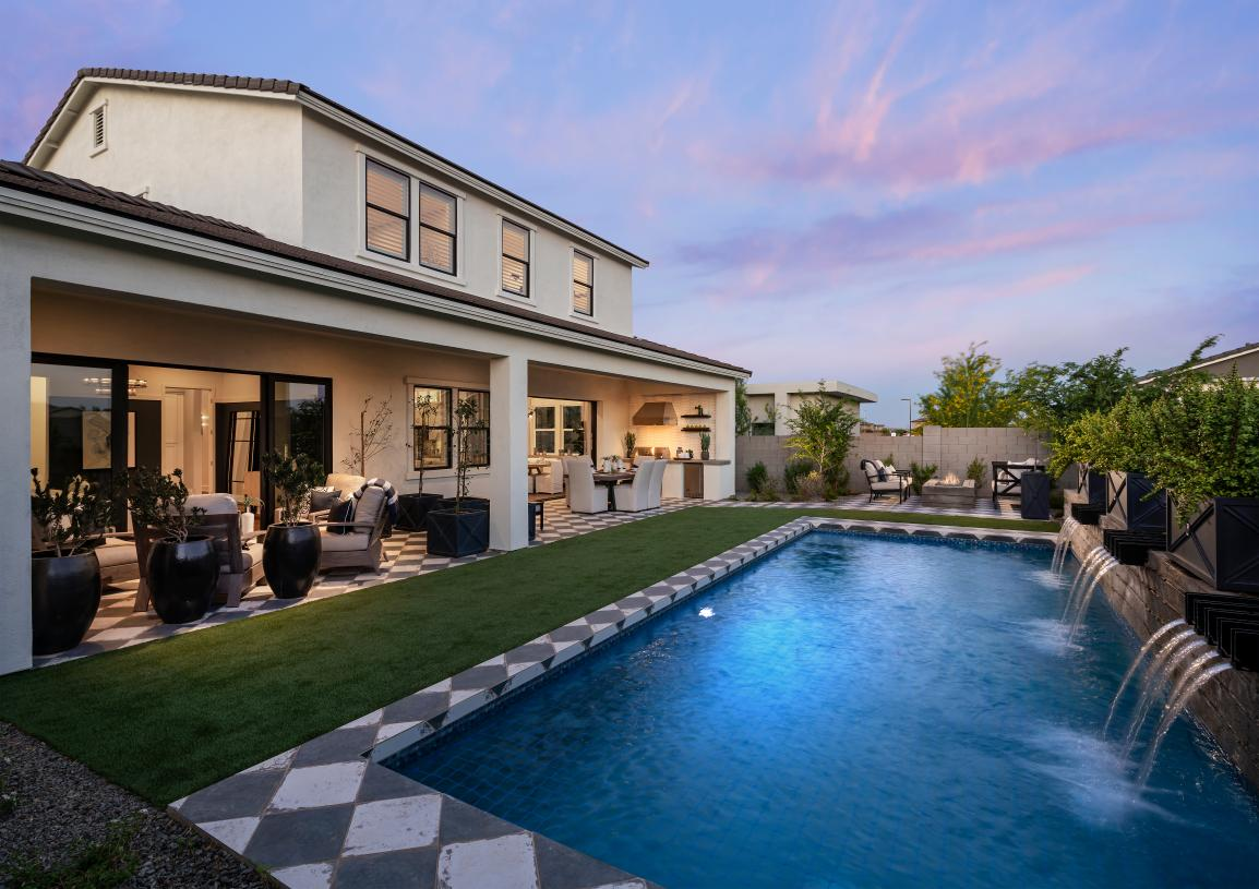 Resort-style backyard with pool and extended covered patio