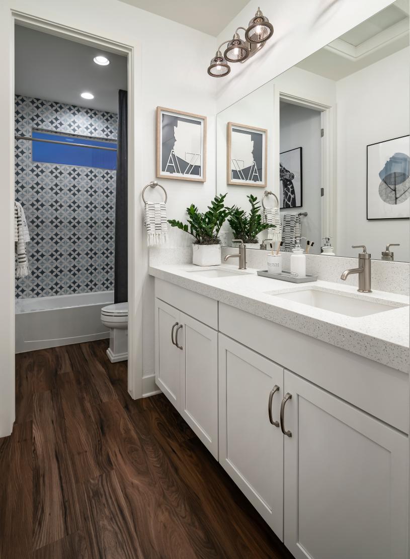 Beautiful secondary bathrooms with dual sink vanities