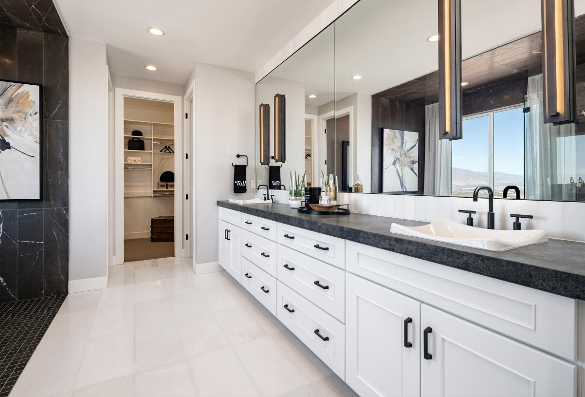 Lavish primary bathrooms with large walk-in shower and ample countertop space