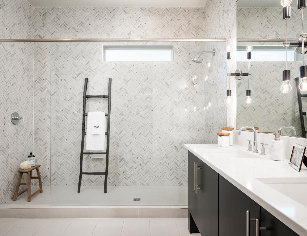 Lavish primary bathroom with huge walk-in closet and dual-sink vanity