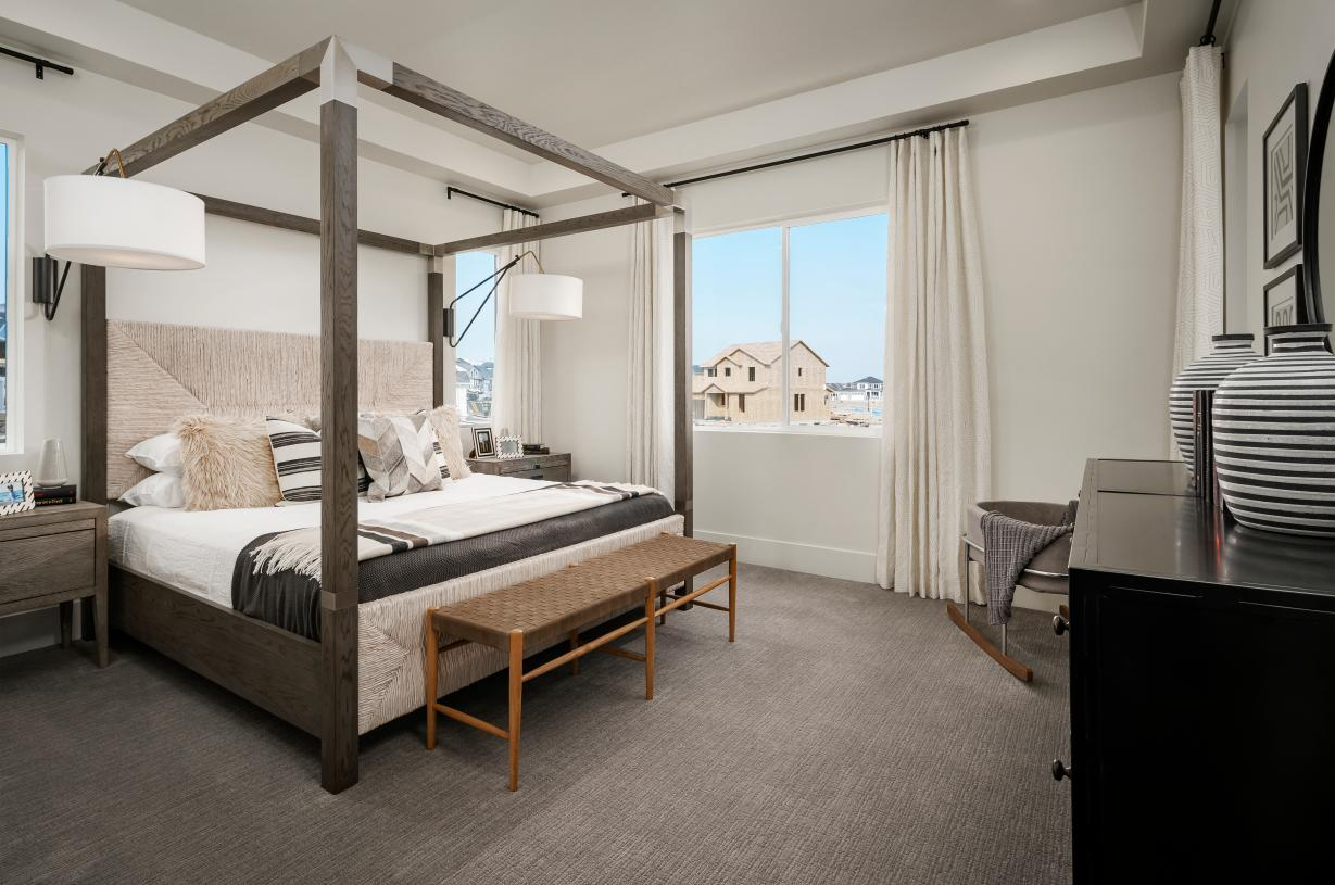Large primary bedroom with beautiful tray ceiling