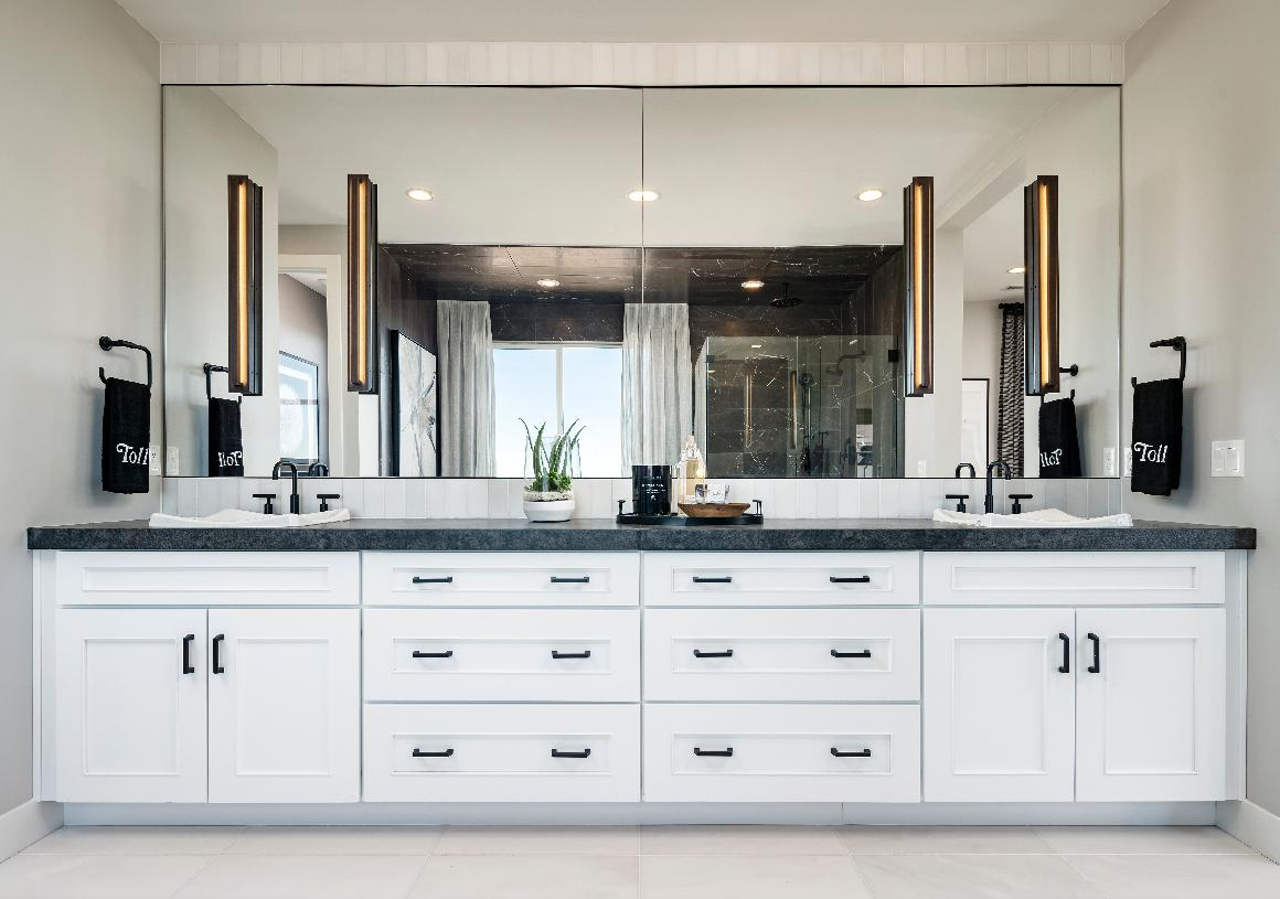 Luxurious primary bath with dual vanity and ample cabinet space