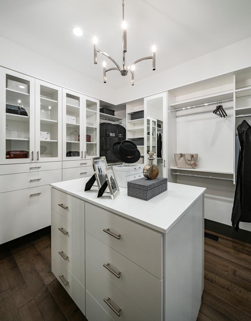 Huge primary closet with ample cabinet and storage space