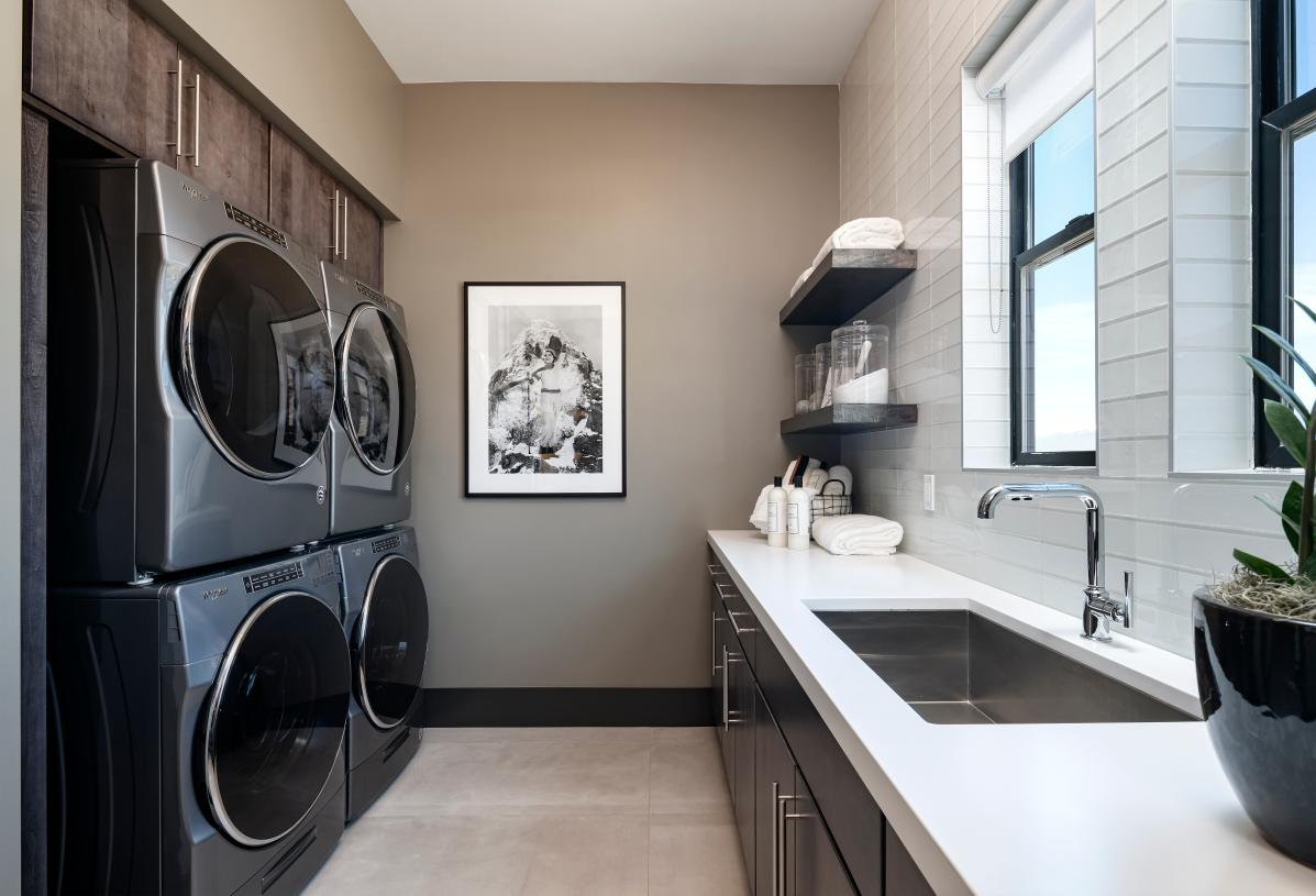 Spacious laundry room with ample countertop and cabinet space