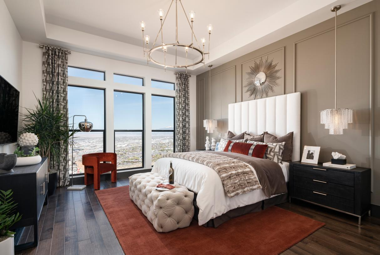 Beautiful primary bedroom suite with ample natural light and adjacent seating area