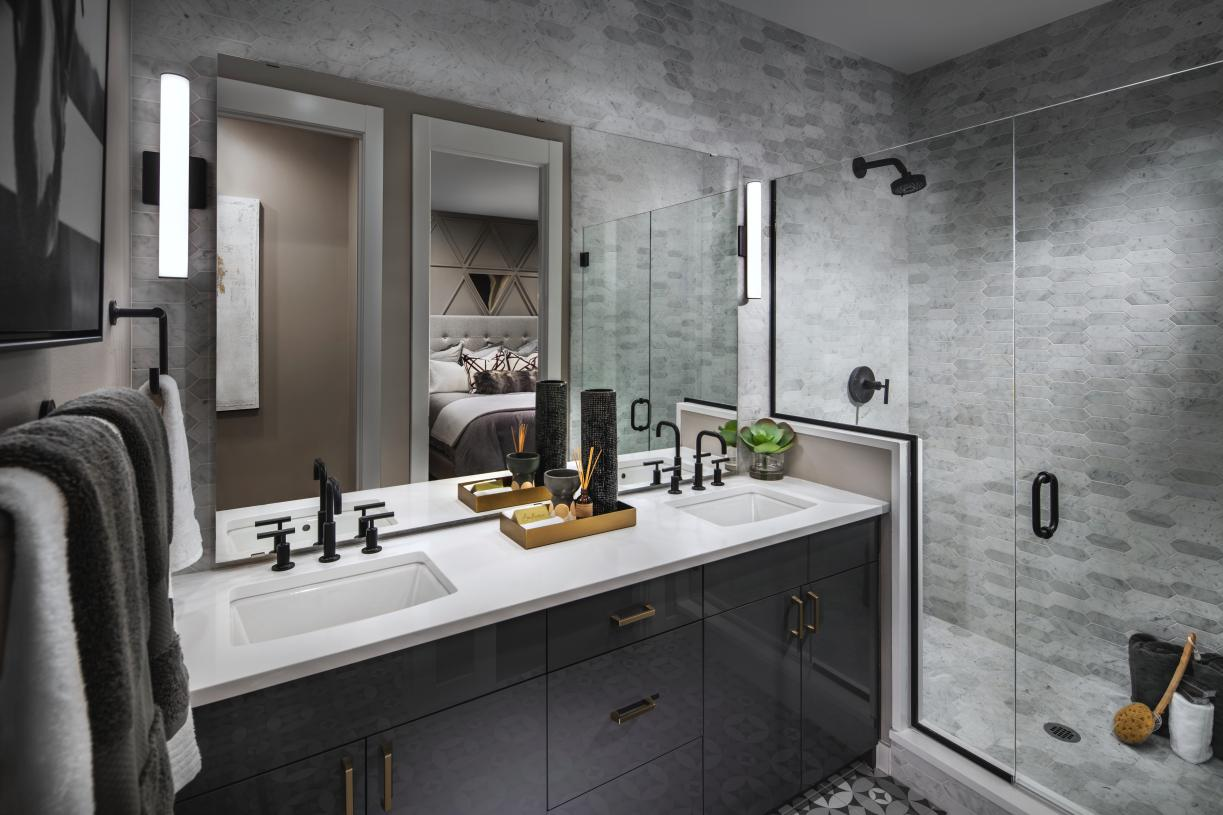 Primary bathroom with dual-sink vanity and large walk-in shower
