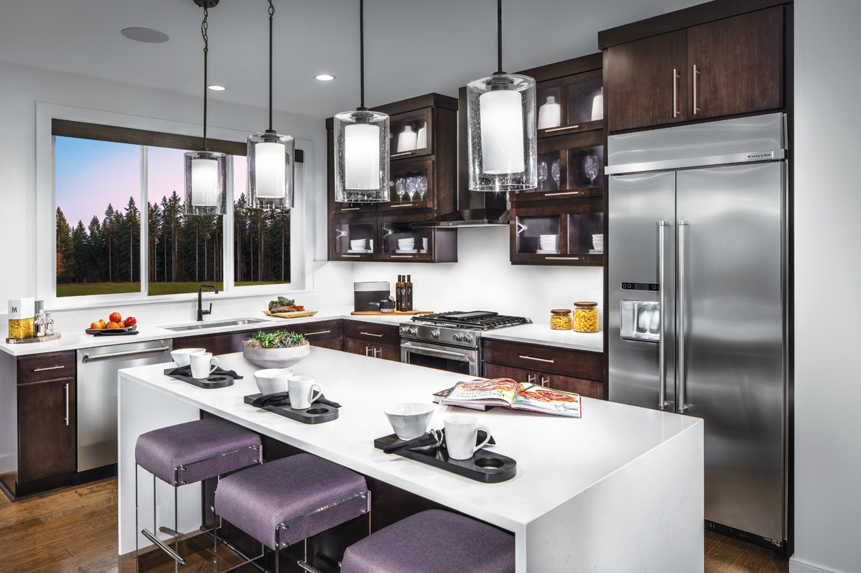 Well designed kitchen includes a large island with seating for three