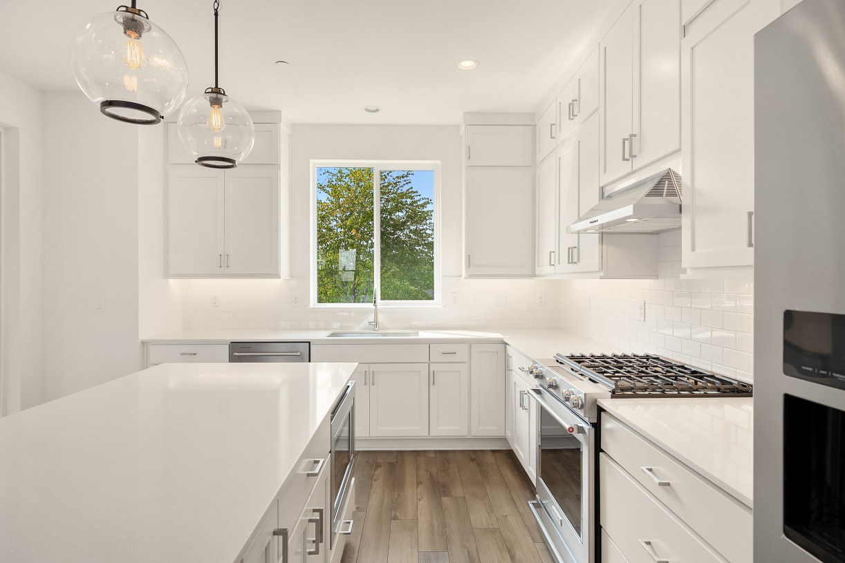Well designed kitchen offers plenty of countertop space and cabinets for storage