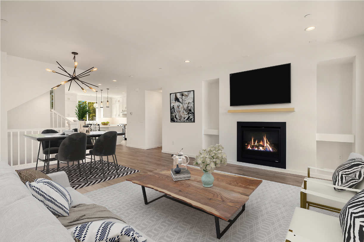 Open concept great room features a cozy gas fireplace