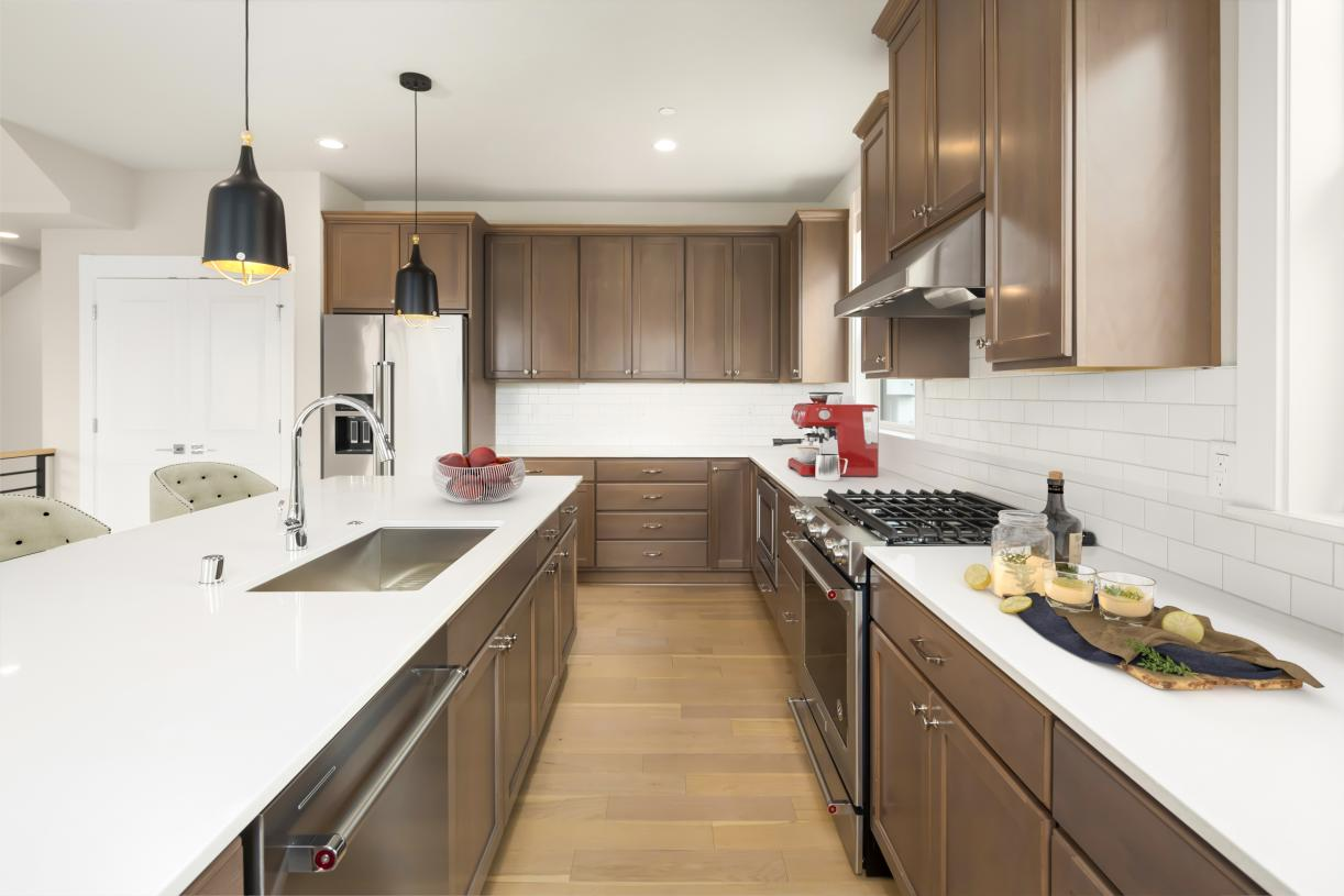 Gourmet kitchen offers plenty of cabinets for storage