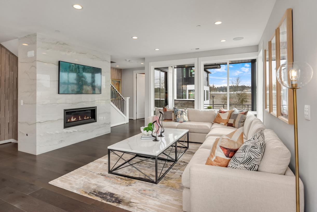 Open-concept great room with a cozy fireplace