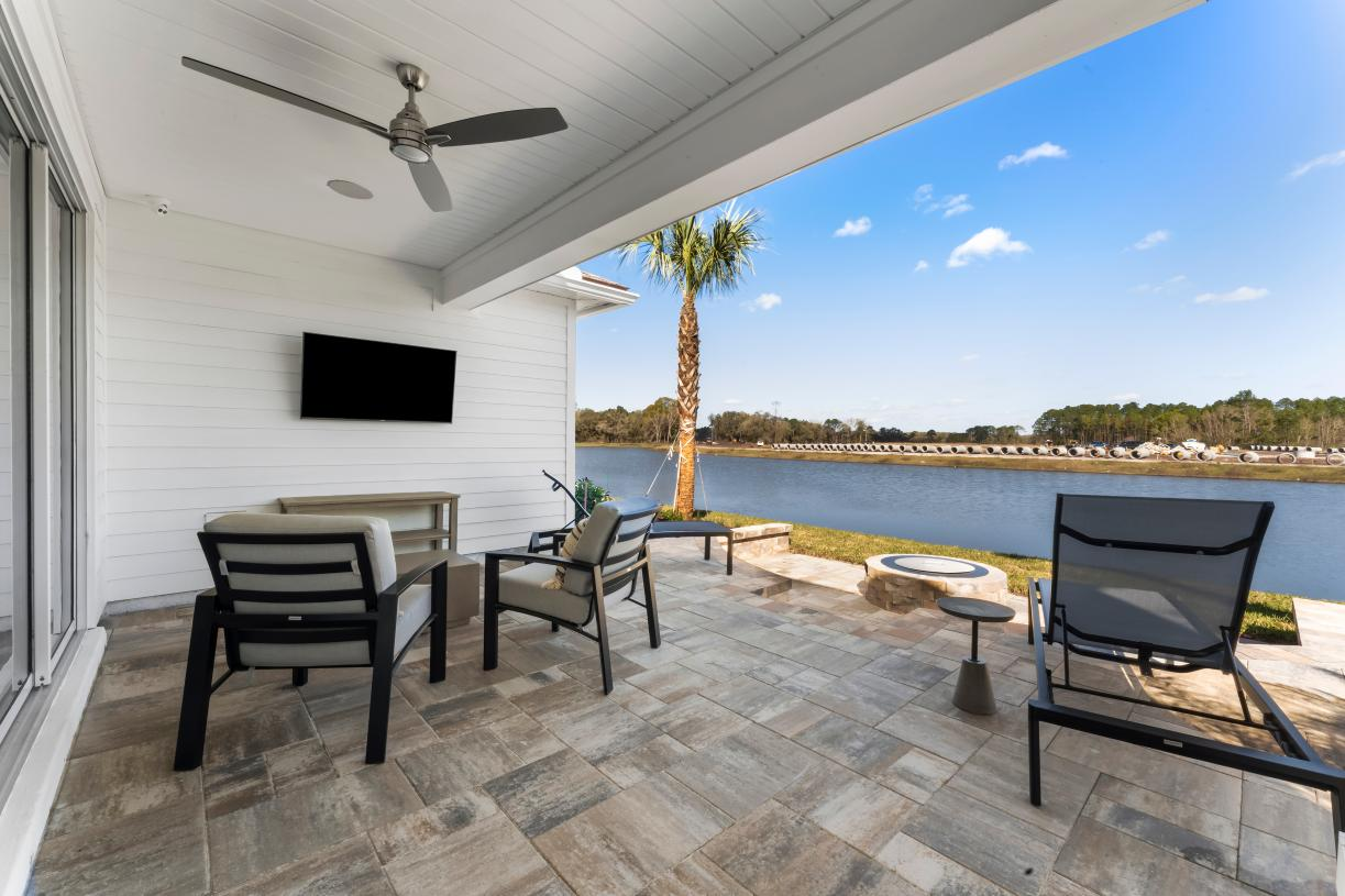 Spacious covered lanai and outdoor fire pit with a view