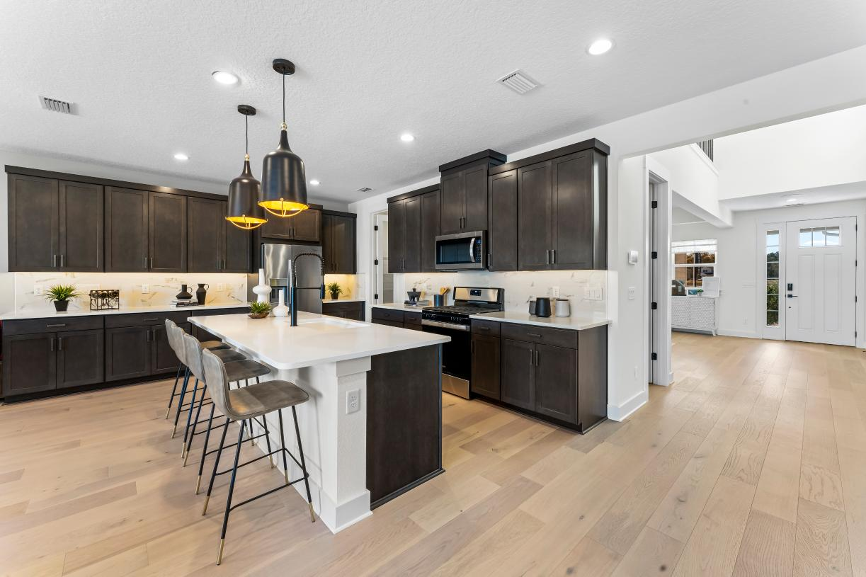 Large open kitchens with walk-in pantries and an abundance of cabinet storage