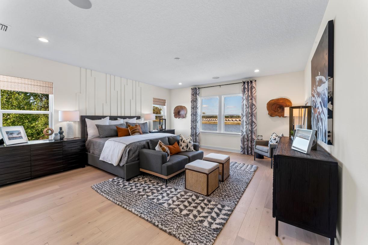 Oversized primary bedroom suites with abundant natural light