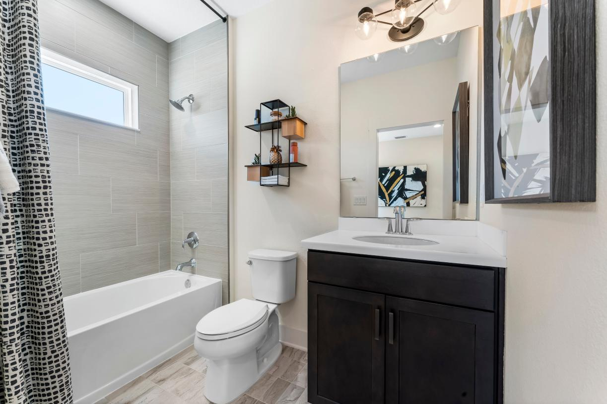 Personalize attached bathrooms with you own design style in our state-of-the-art design studio