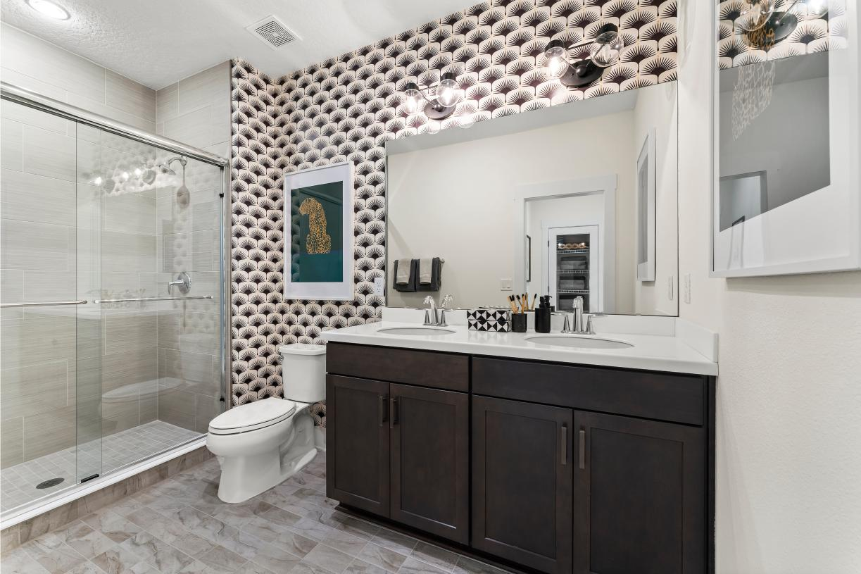 Spacious secondary bathrooms with dual-vanities and walk-in shower