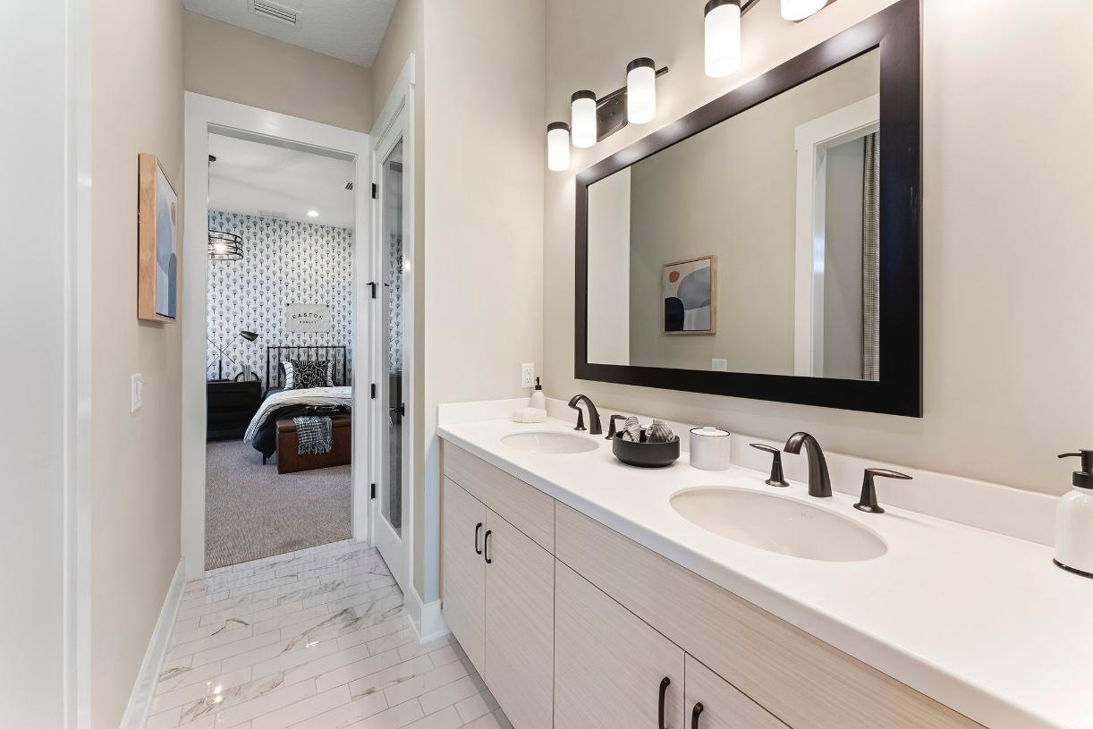 Secondary bathrooms with dual vanities and linen closets