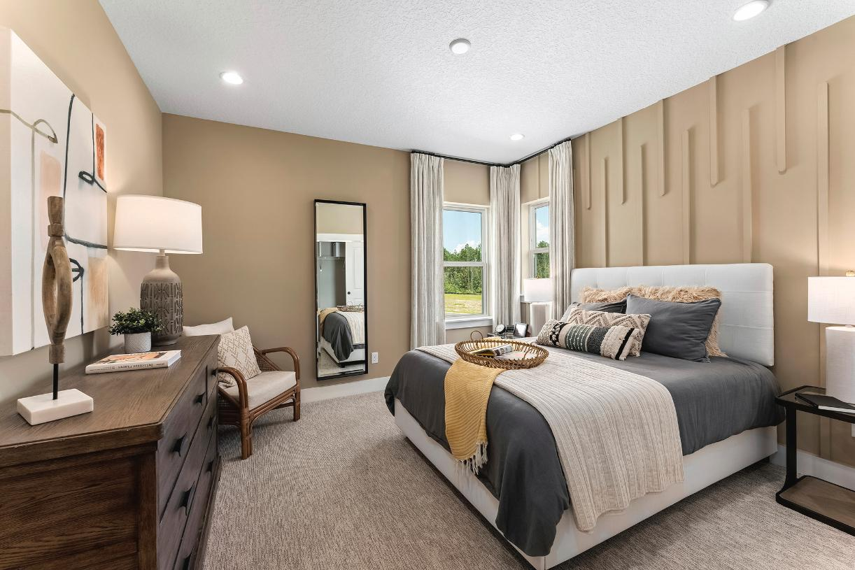 Expansive secondary bedrooms with abundant natural light