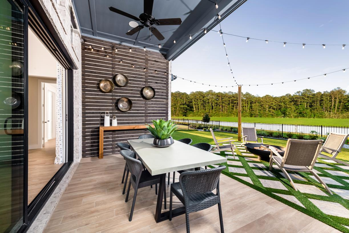 The Adam's covered patio extends from the great room