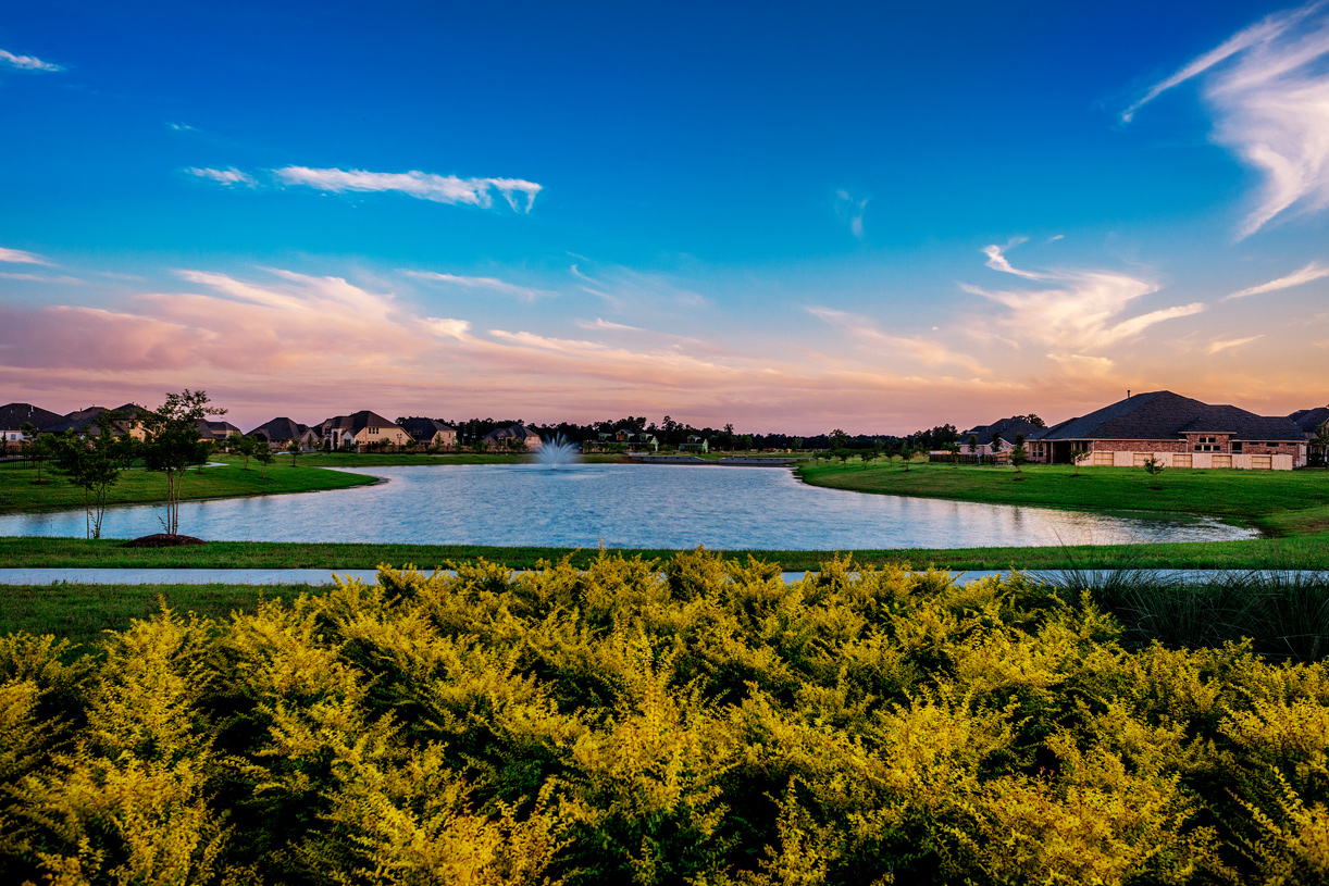 Enjoy a scenic stroll around the community lake in Lakes at Creekside, Tomball, Texas - Harris County