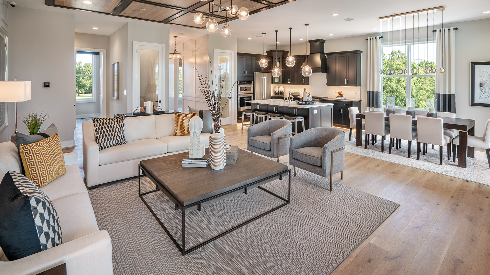 Open-concept kitchen, great room, and dining room are ideal for entertaining