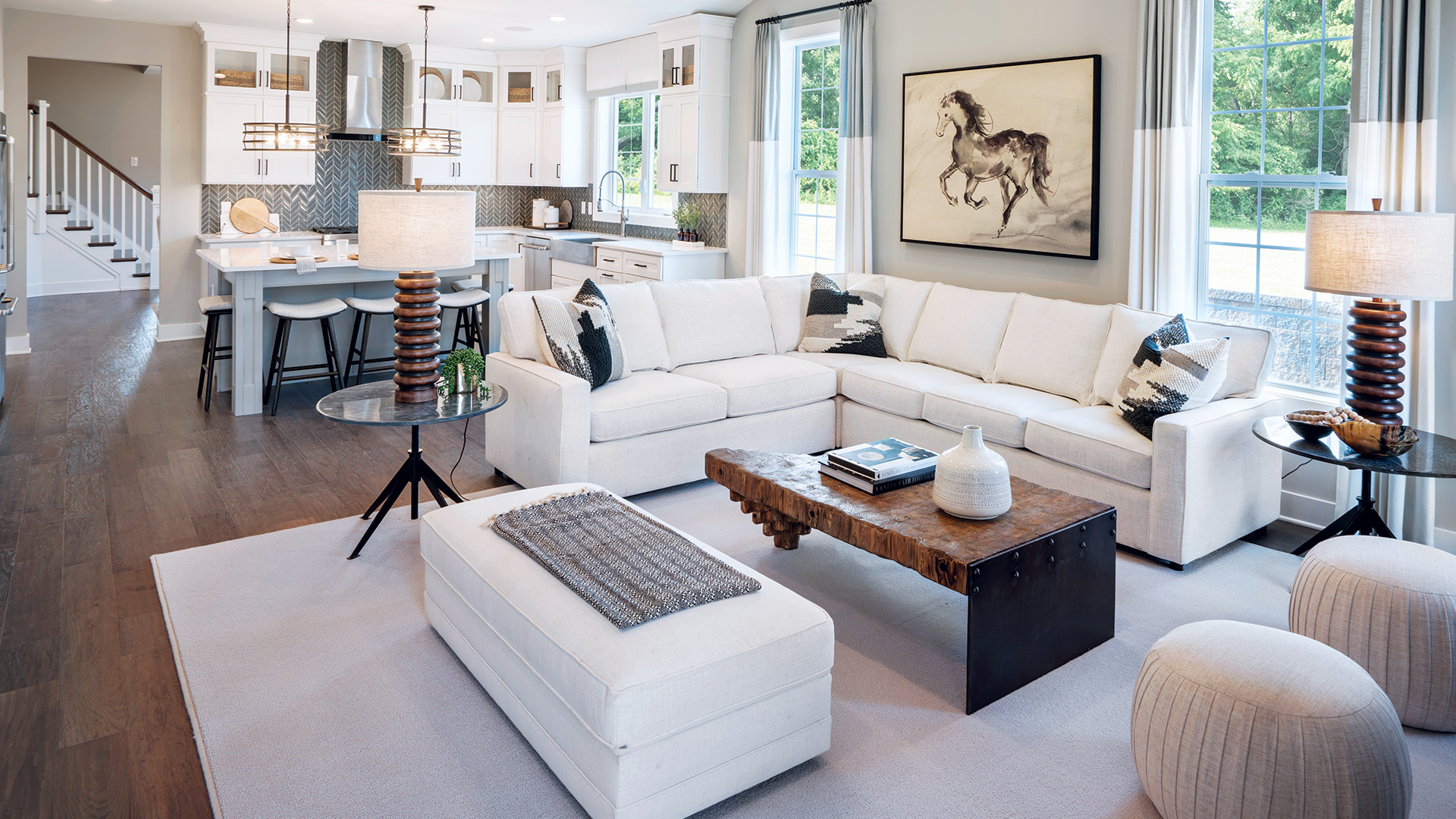 Brand-new home designs with first-floor primary bedroom suites and open-concept layouts