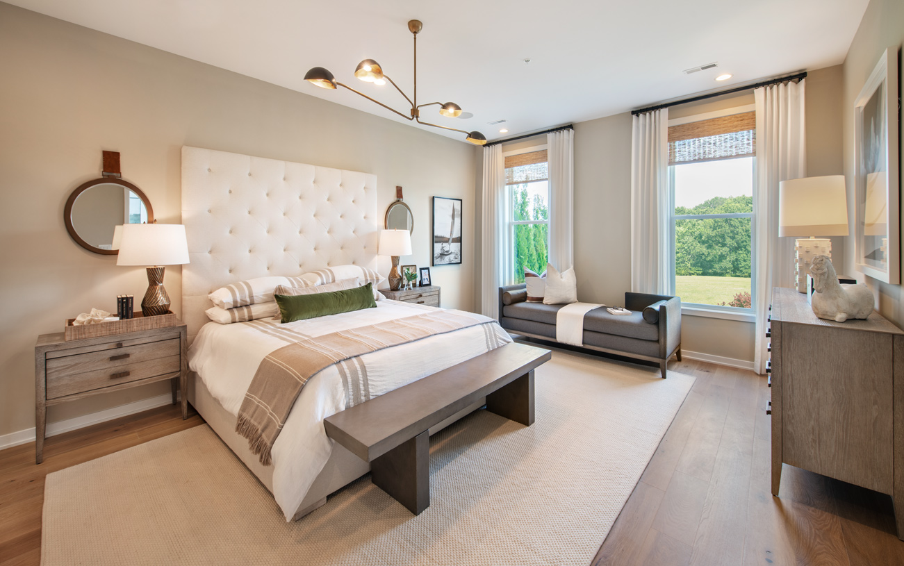 Expansive first-floor primary bedroom suites