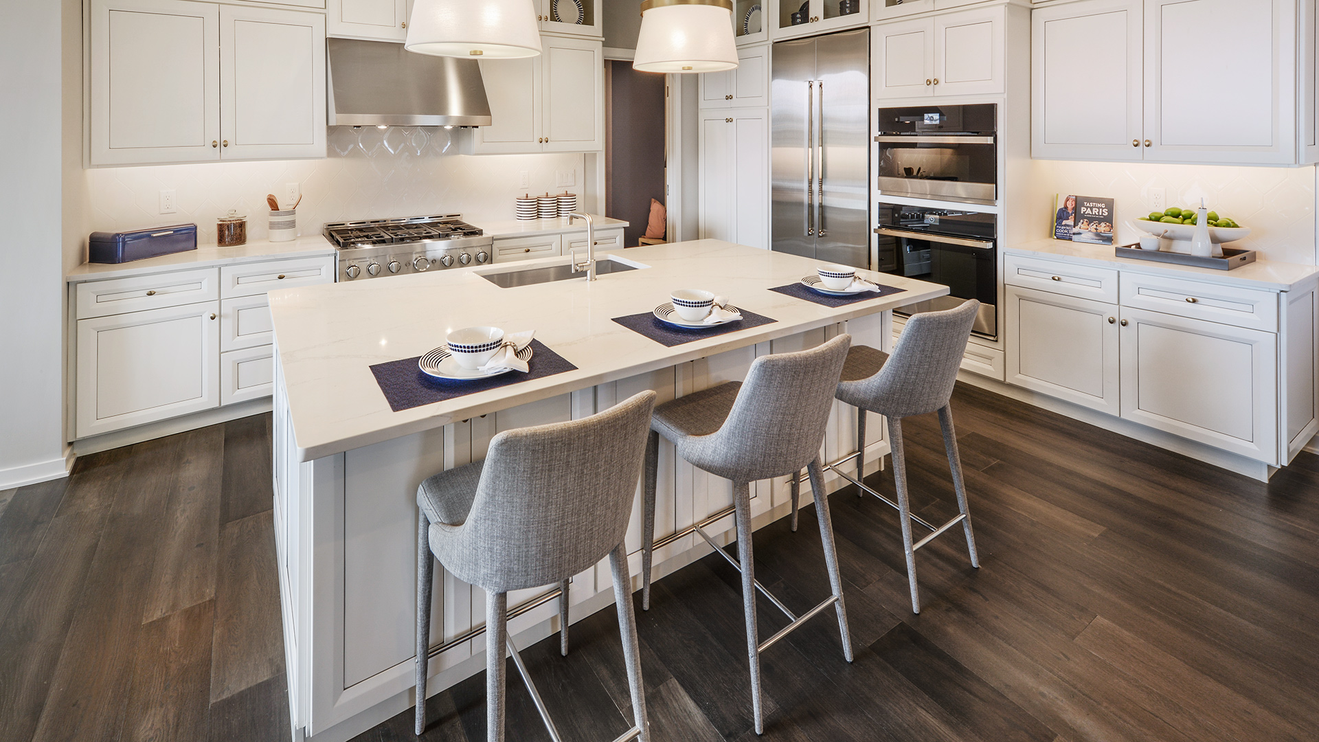 Spacious kitchen with center island and stainless-steel appliances