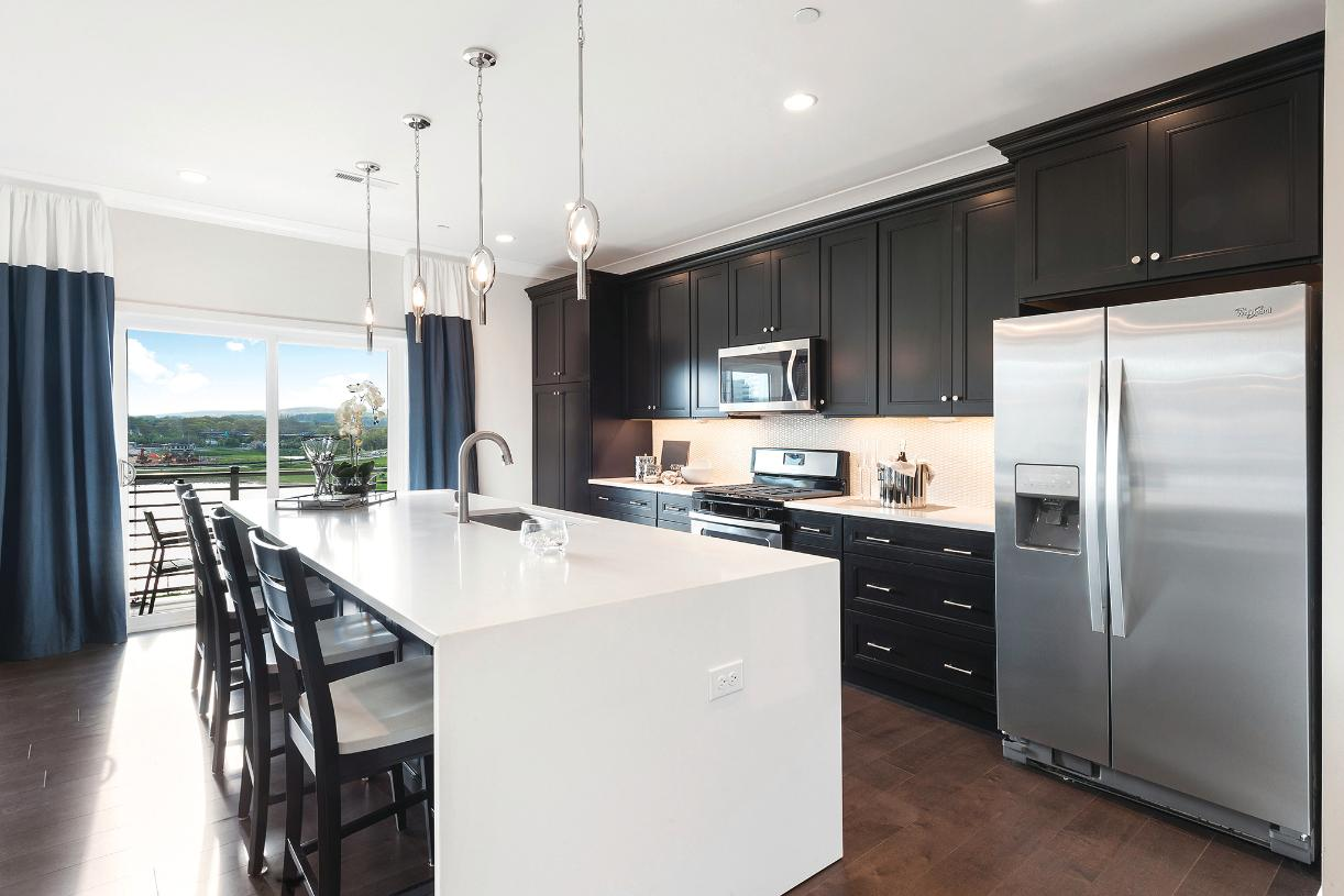 Well-appointed kitchens with stainless steel appliances