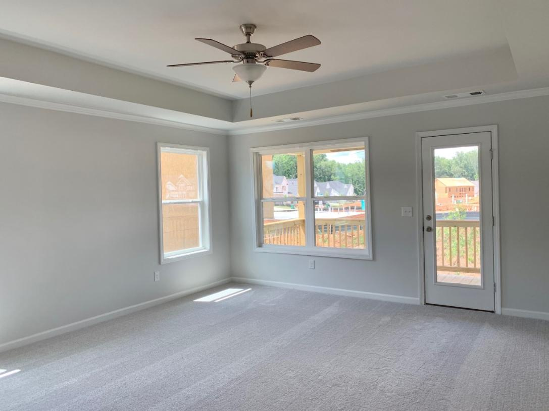 The appealing primary bedroom suite boasts a walk out covered porch, lavish bath, ample closet space