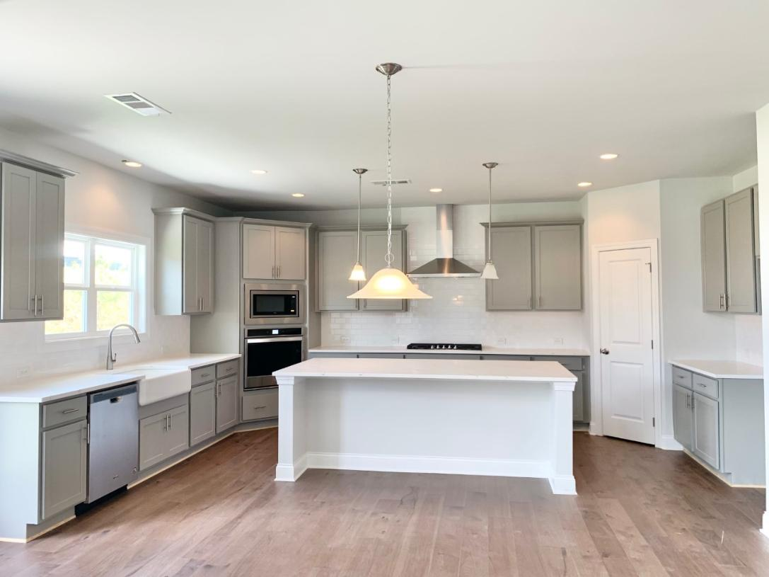 The oversized kitchen island provides a centerpiece for entertaining
