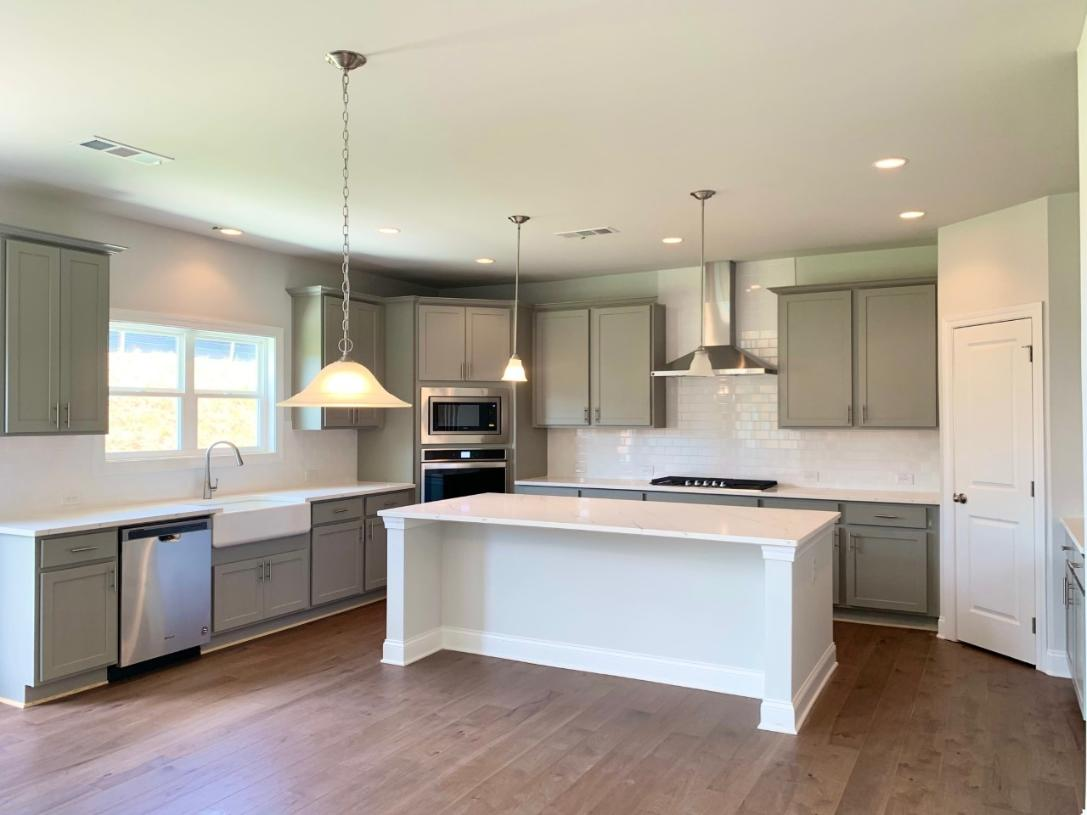 A well-appointed kitchen boasts stainless steel appliances, upgraded countertops, and ample storage space