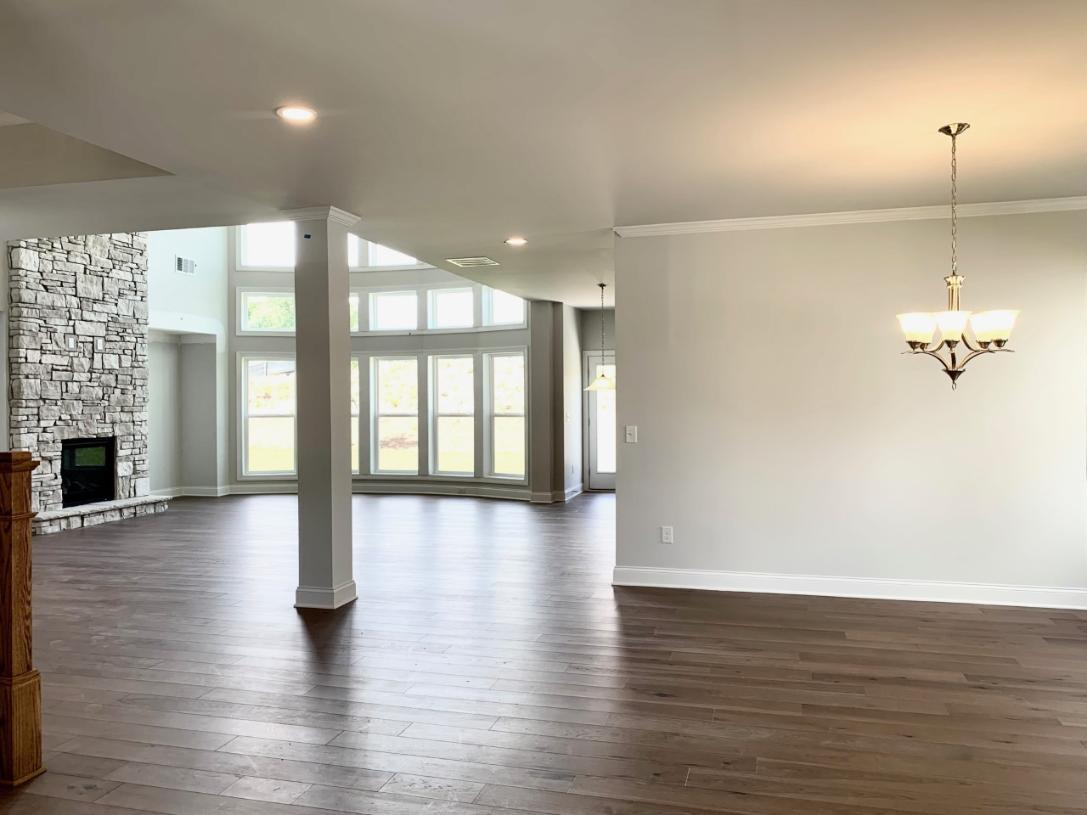The open-concept kitchen, great room, and dining room are ideal for entertaining