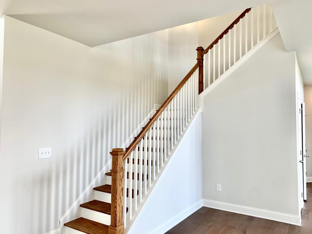 The dramatic front-entry offers a two-story foyer and impressive staircase